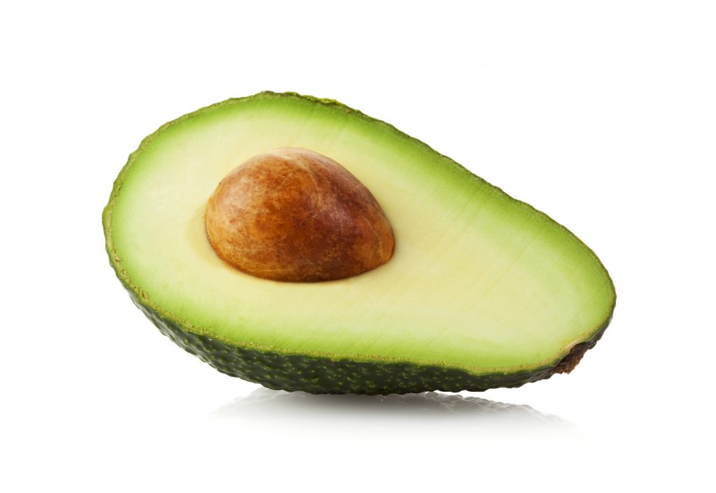 Halved Avocado fruit isolated on white with clipping path